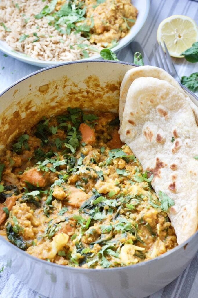 Easy Cauliflower & Lentil Curry - curry in a pot with some flat bread