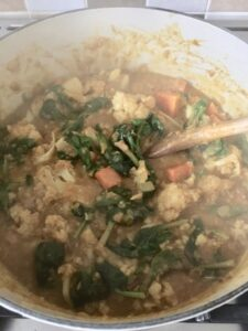 Easy Cauliflower & Lentil Curry - all veggies are being mixed in well