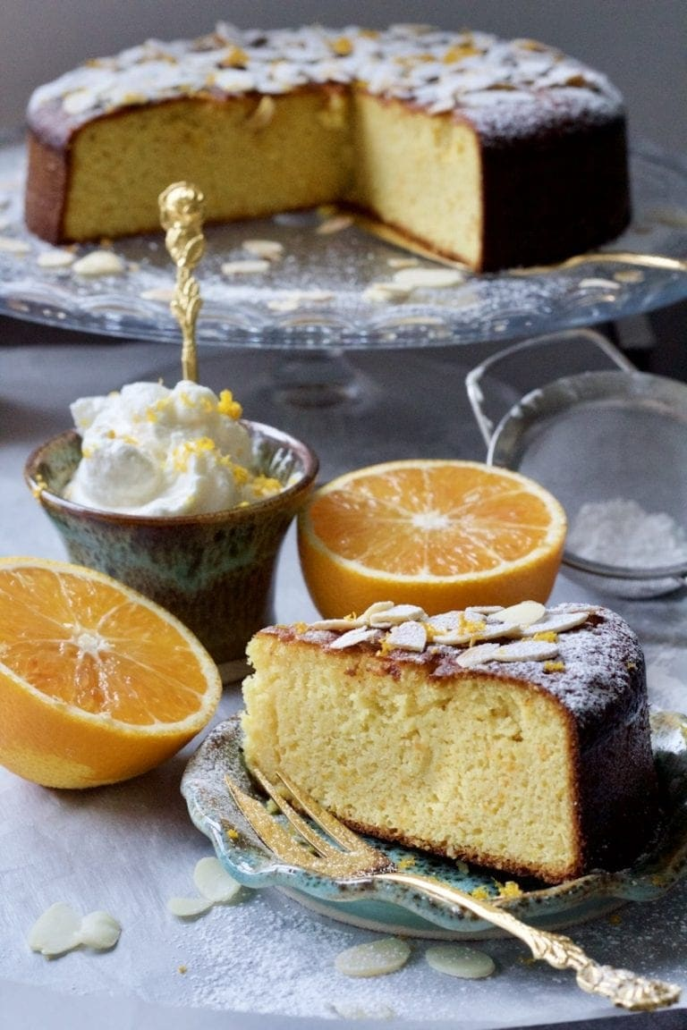 Gluten-Free Orange and Almond Cake slice with cake in the background