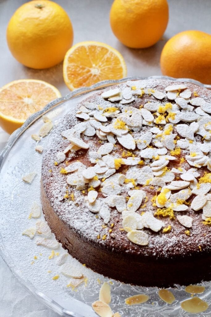 Whole Gluten-Free Orange and Almond Cake on a cake stand