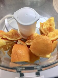 Gluten-Free Orange and Almond Cake - chunks of oranges in the food processor ready for pureeing