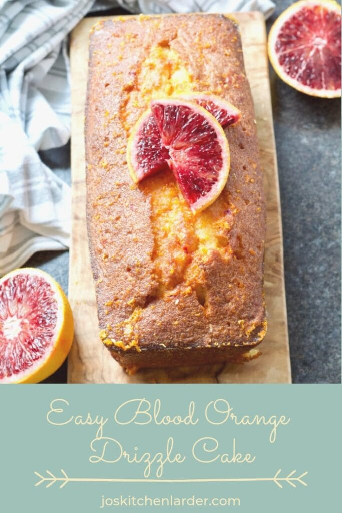 Easy Blood Orange Drizzle Cake on the board decorated with orange slices