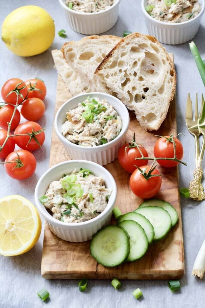 Smoked Mackerel Pate - pate in ramekins on serving board with bread and veg garnishes