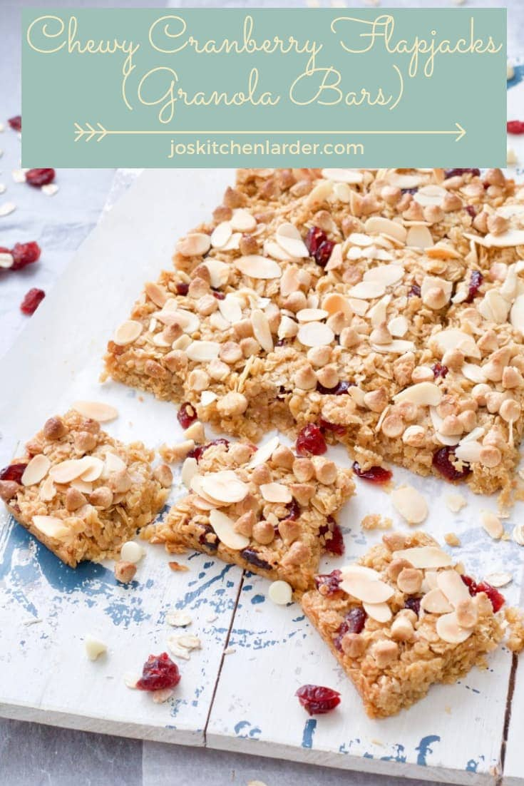 These Chewy Cranberry Flapjacks (Granola Bars) are so moreish! Sprinkled with almond flakes & white chocolate chips, they're real treat! They make delicious snack or even breakfast on the go! #flapjack #granolabar #cranberries #almonds #whitechocolate #snack #breakfast