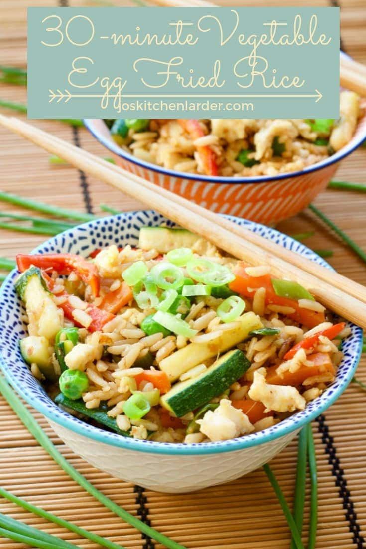 Vegetable Egg Fried Rice in a bowl with chopsticks