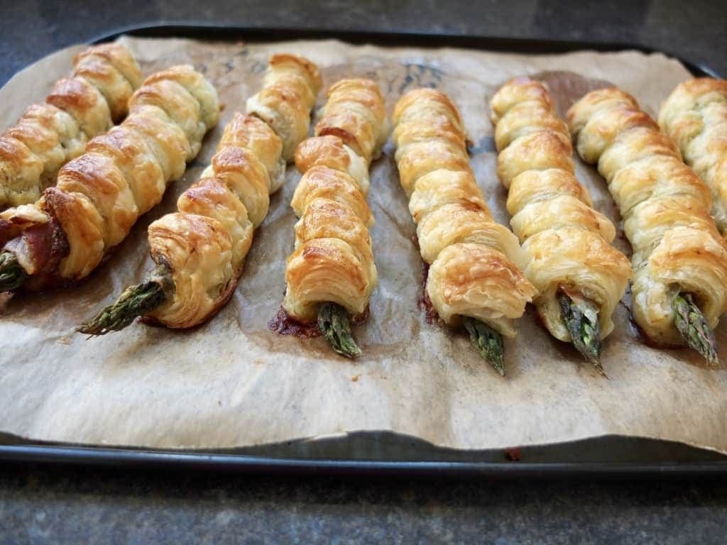 Asparagus Puff Pastry Twists on a baking tray