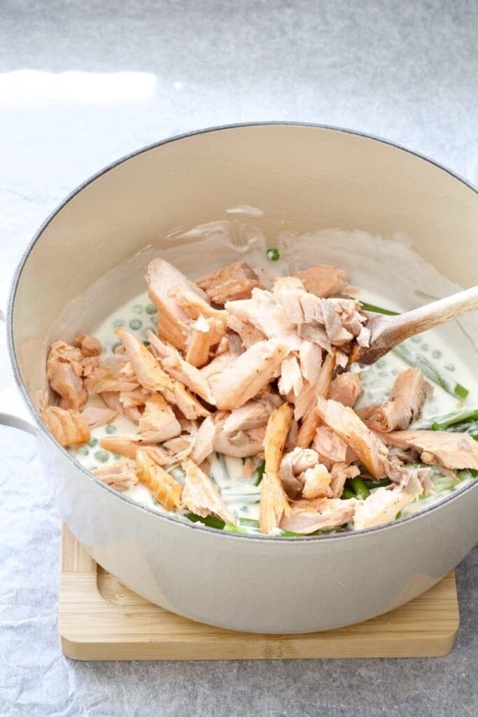 Pot with creamy sauce & flaked salmon.