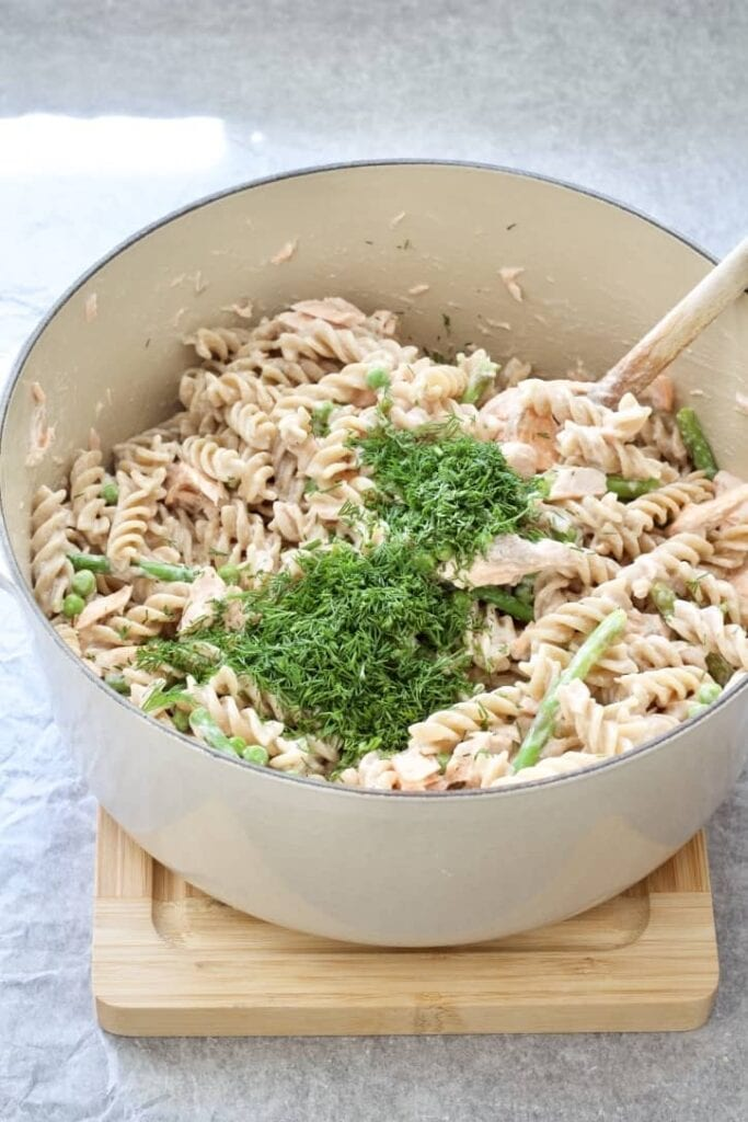 Pot with pasta and lots of chopped dill on top.