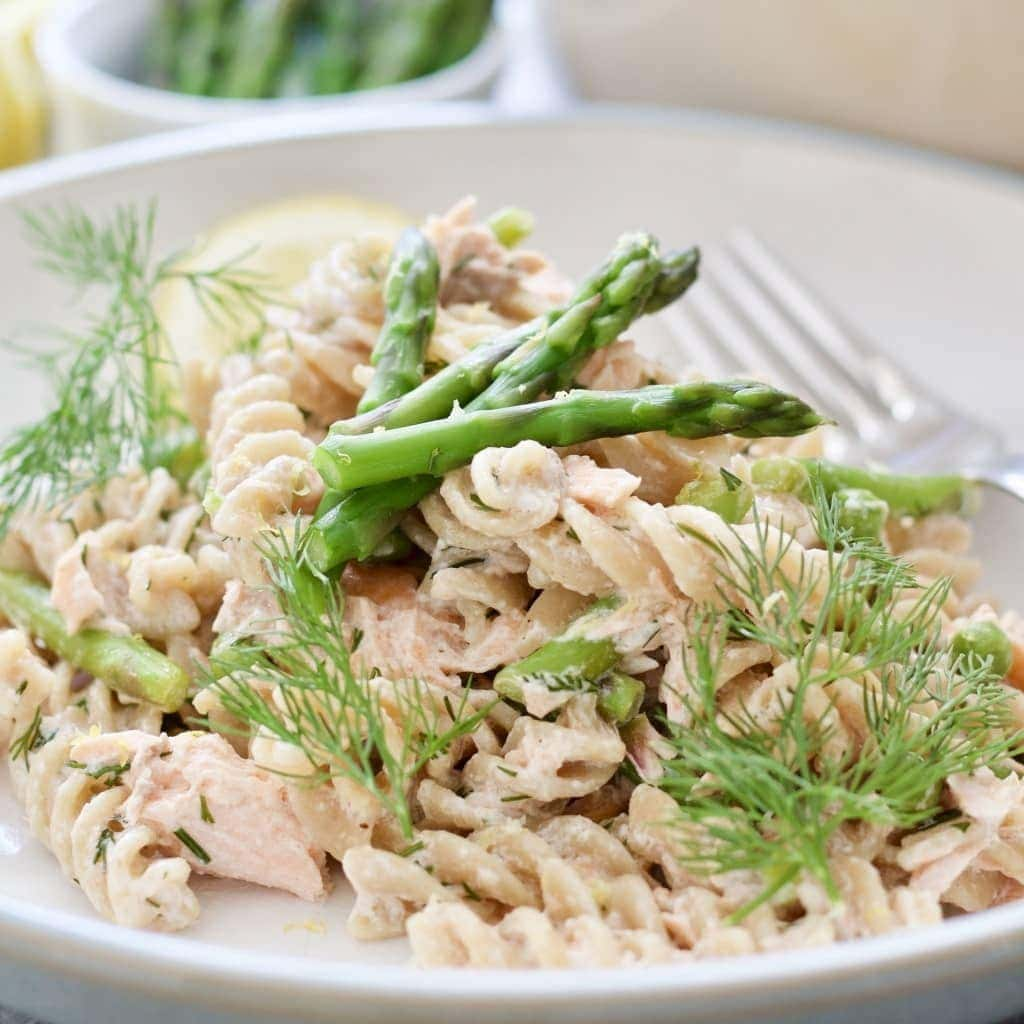 Plate with pasta & asparagus, close-up.