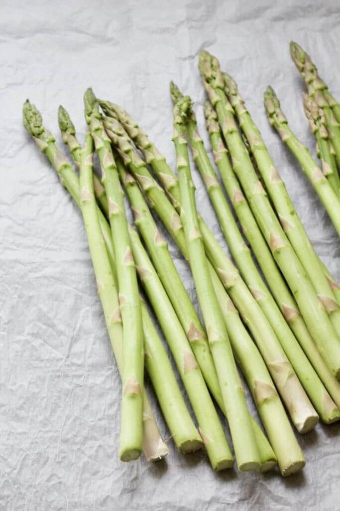 asparagus spears on a parchment