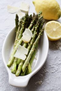 roasted asparagus in a dish with parmesan