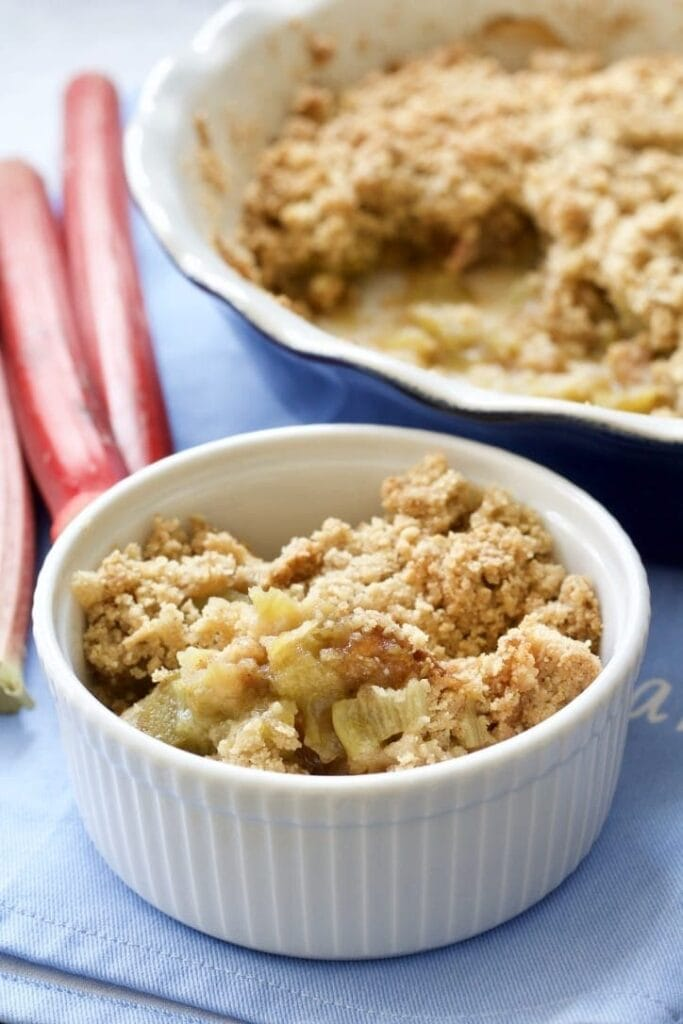 Rhubarb crumble in a bowl and in a dish.