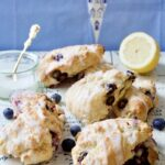 Blueberry scones with lemon glaze on the board.