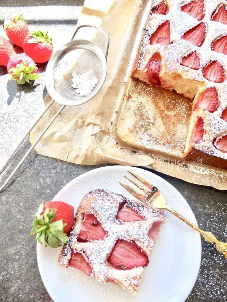 Slice of strawberry cake on a plate.