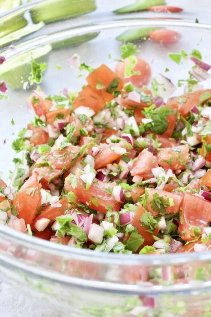 Fresh tomato salsa in a large glass bowl.