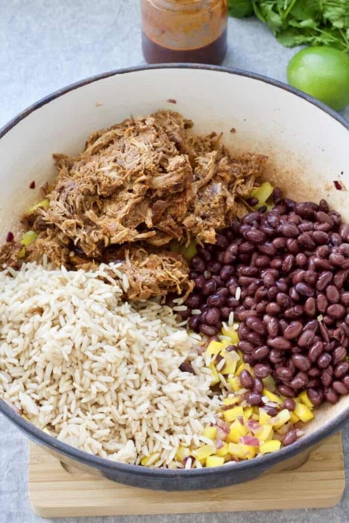 Rice, meat, beans & pepper in a pan.