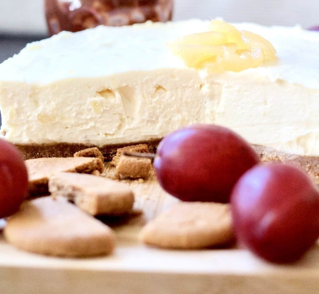 Stem ginger cheesecake on a boars with plums & biscuits.