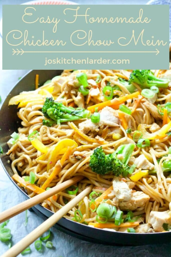 Chicken chow mein in a pan with chopsticks.