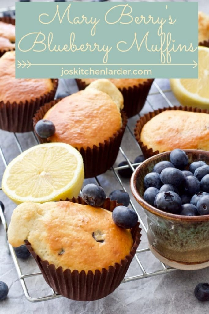 Blueberry muffins on a cooling rack (pin).